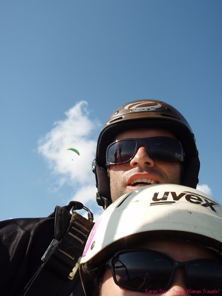 Single Woman with paragliding instructor in the sky