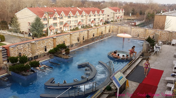 Outdoor spa pool with built-in body massage jets at Spa Castle NYC