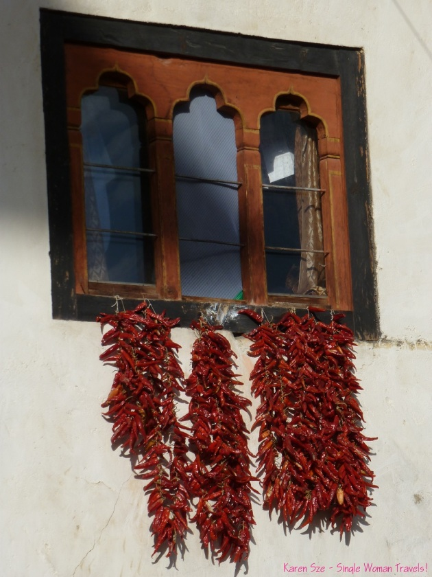 Chili strung together to dry in Paro, Bhutan. Functional and Decorative.