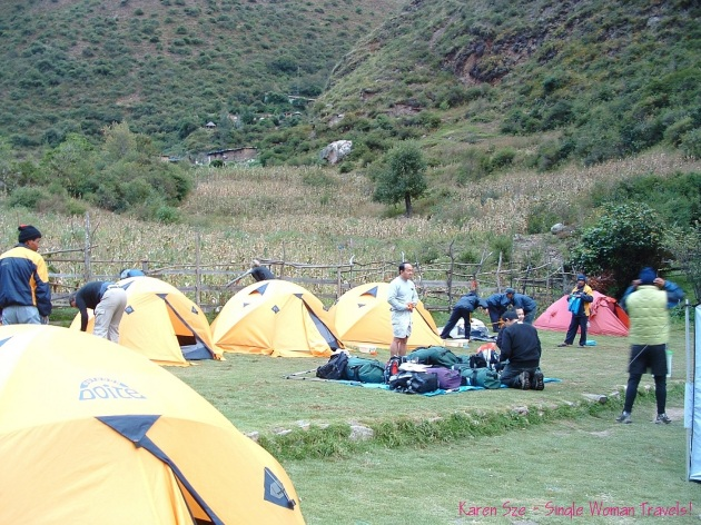 camping on the Inca trail in yellow tents Peru
