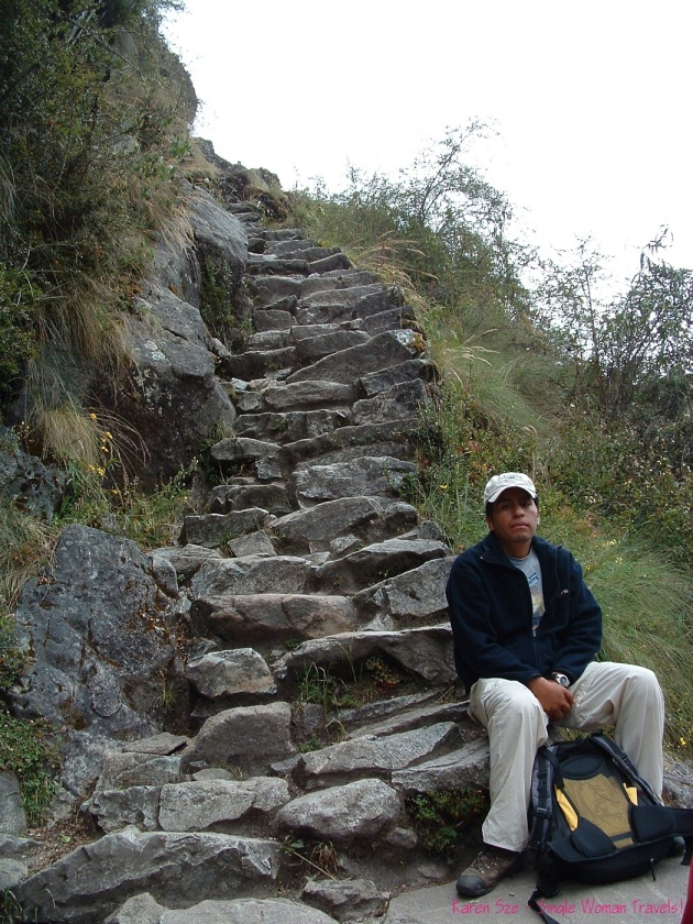 Hiking Inca trail Peru with steep stone steps