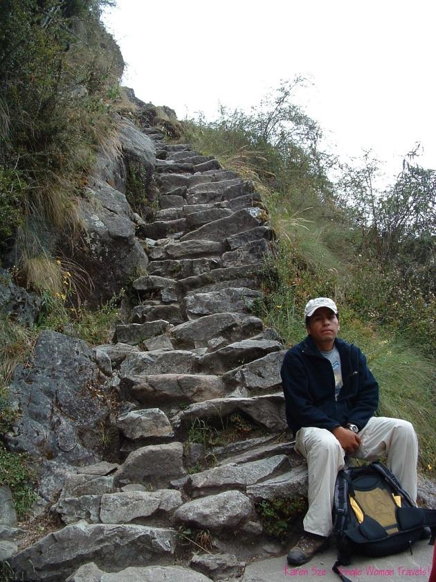 Hiking Inca trail Peru with steep stone steps