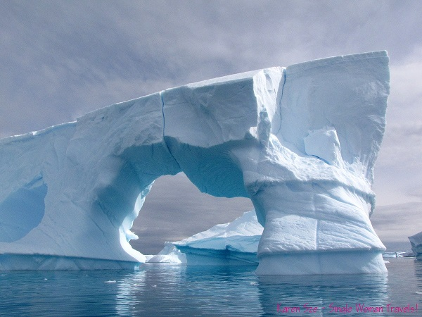 Large tabular iceberg with natural archway in Antarctica