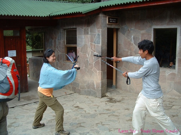 random fun dueling fencing with hiking poles Machu Picchu Peru