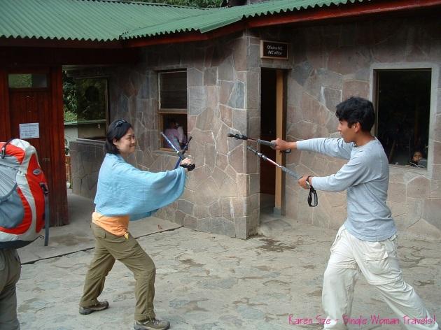 random fun dueling fencing with hiking poles Machu Picchu Peru