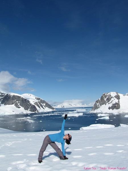 Single Woman in Trikonasana at Orne Harbour, Antartica (Jan 2013)