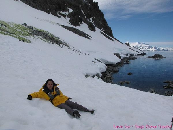 Single Woman taking a break after making a snow angel