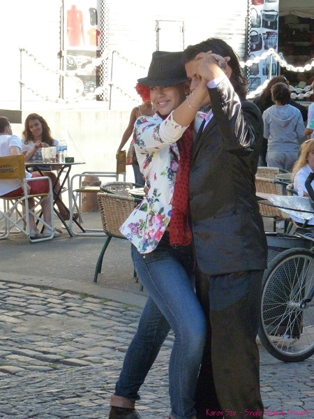 Tango dancing on streets of La Boca, Buenos Aires, Argentina