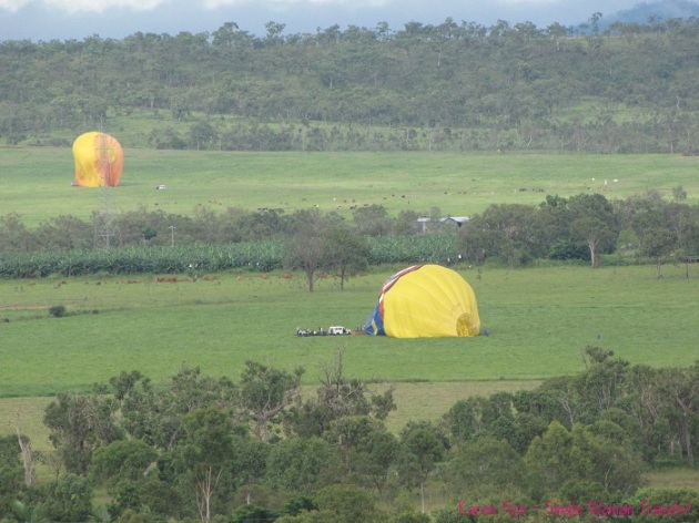 Deflating hot air balloon in farmer field in Australia