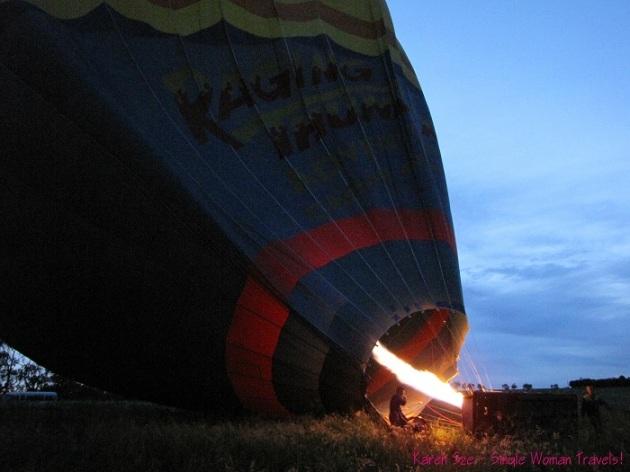 Inflating hot air balloon at dawn