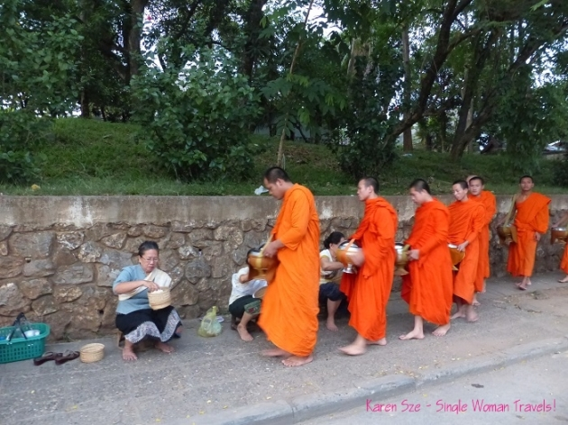 Morning Alms for Laotian monks Luang Prabang Laos