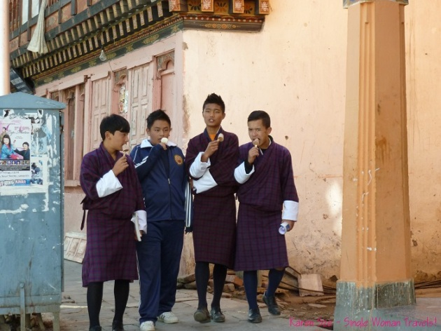 Students in Bhutan wearing traditional Gho, a knee-length robe  tied at the waist by a traditional belt known as Kera