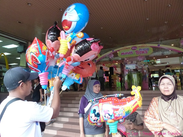 Balloon vendor at entrance to Malioboro shopping mall