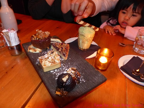 Dessert platter of Sticky toffee pudding, Cioccolato - a chocolate quinoa cake, Tortino di Mele - apples almonds, maple syrup and a pistachio gelato,