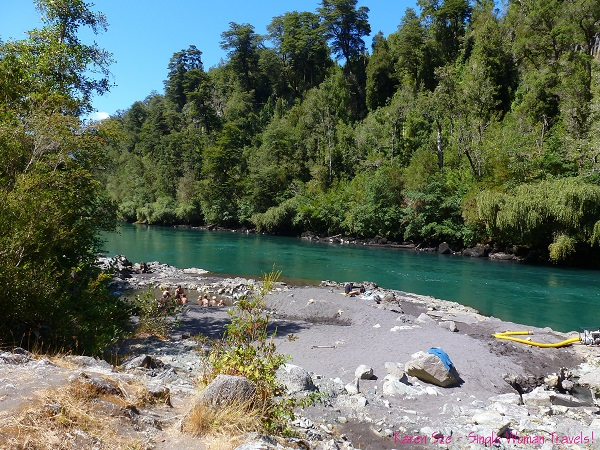 First view of Termas de Ralun on the shore of Petrohue river in Chile