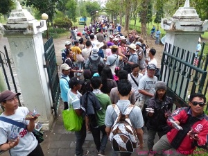 Hawkers swarm tourists at the exit gate of Borobudur, Indonesia