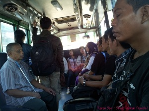 Passengers in public transit bus in Jogja, Indonesia