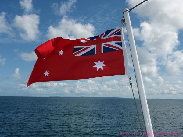 Australian flag with blue skies
