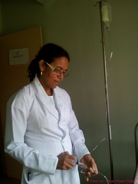 Brazilian nurse administer medication to treat Dengue fever in Abadiania, Brazil