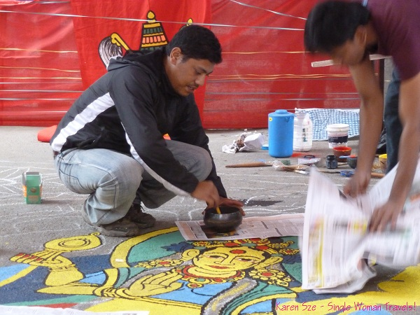 Nepali men decorate the street of Kathmandu for Diwali