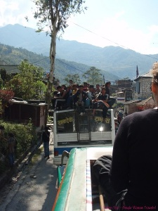 Nepali rides on top of the local bus