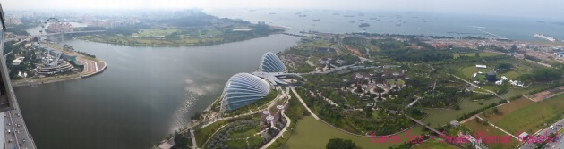 Panoramic view of Singapore Flyer and Gardens by the Bay in Singapore from Marina Bay Sands