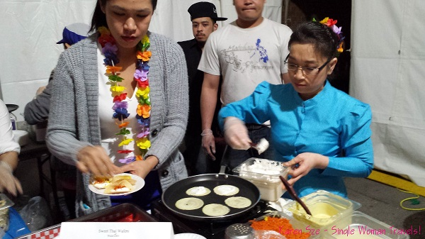 Thai women making khanom buaing in Toronto for Songkran