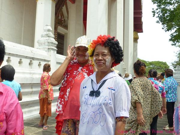 Thai women smeared with chalk on their faces to celebrate Songkran 2013