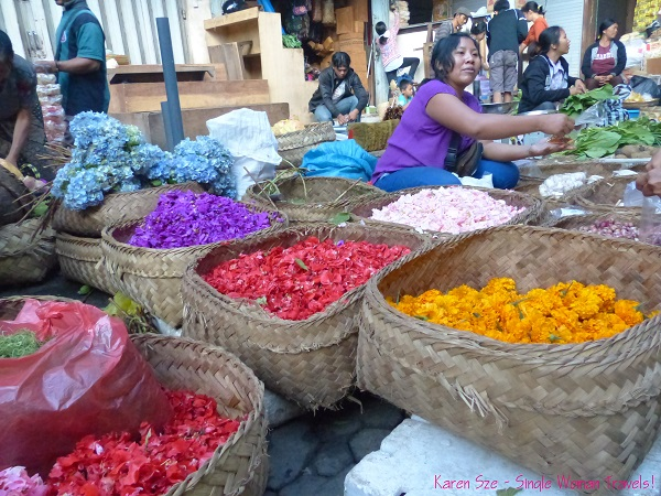Vendor of flower petals for daily Balinese offerings