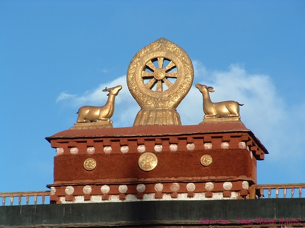 Dharma wheel and symbolic deer on top of Jokhang Temple, Lhasa, Tibet