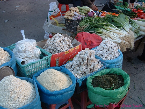 Dried goods sold along side with fresh vegetables