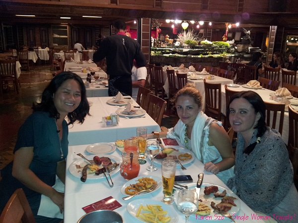 Enjoying dinner with new friends in Porcao Rio, Brazil