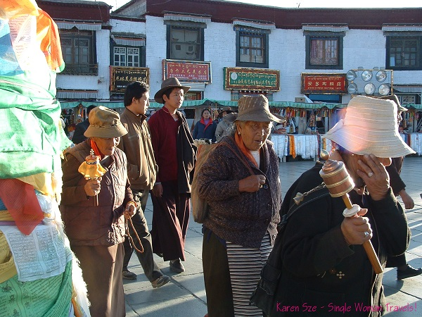 Old Tibetan Buddhists with Prayer wheels in hand