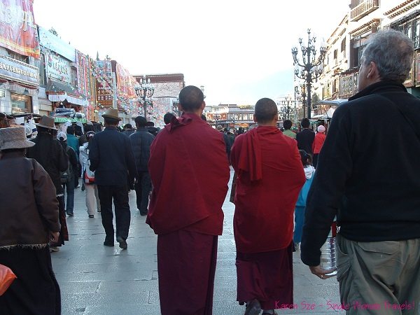 Tibetan monks on a busy street in Lhasa, Tibet