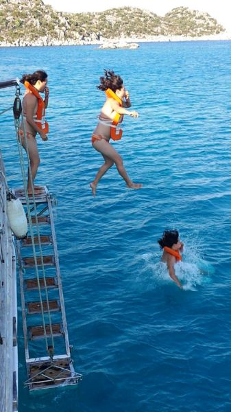 Single Woman leaps into deep blue Mediterranean Sea