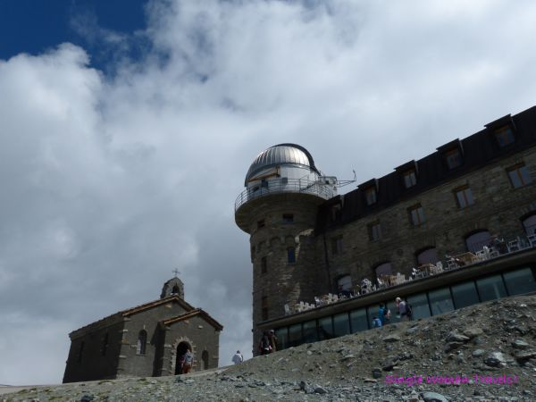 Little old church and telescope at top of Gornergrat Switzerland