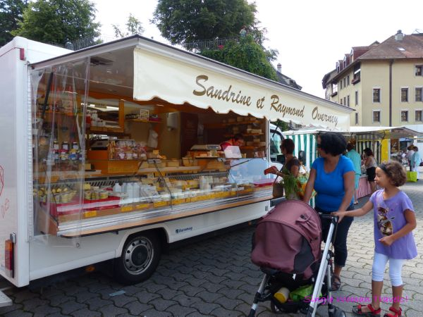 Cheese vendor in Lausanne farmer market Switzerland