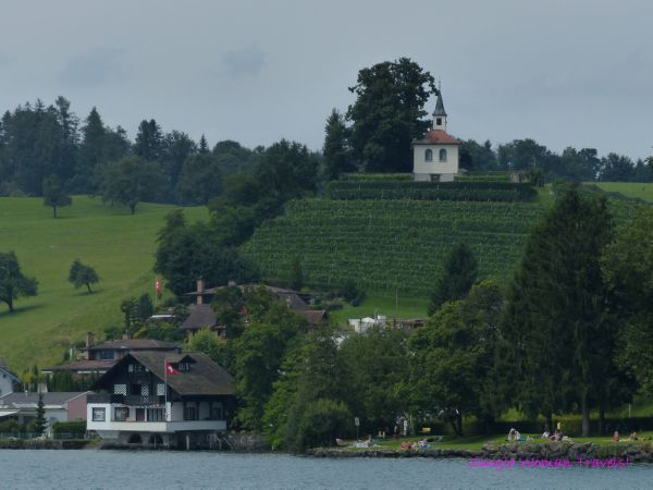 Pretty church on the hill on Lake Lucerne Switzerland