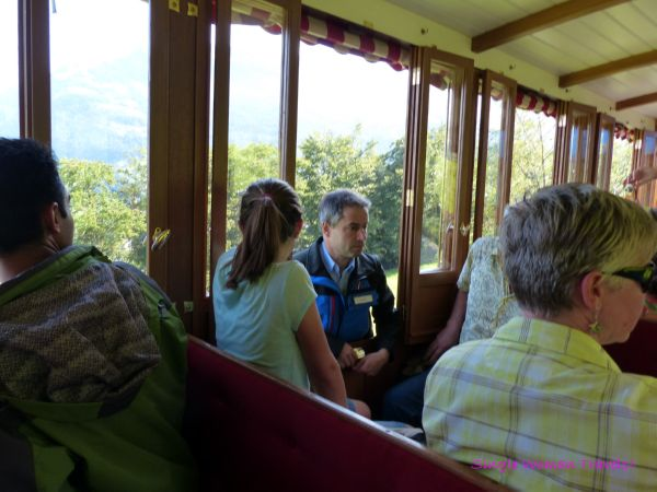 Train ticket checking from outside carriage Switzerland Mt Rigi