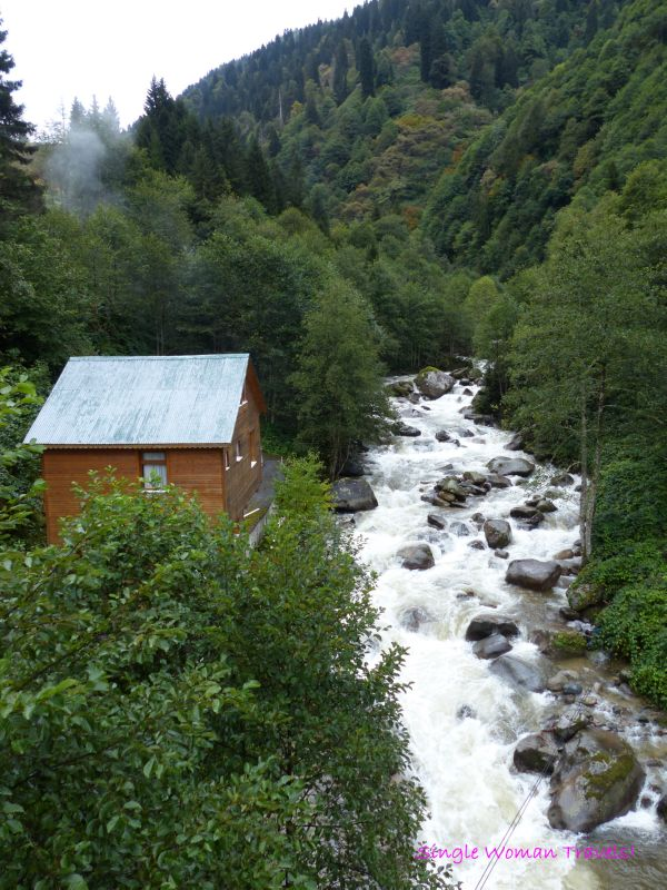 Rushing waters and quaint small wooden cabin Ayder Kaçkar Mountains Turkey