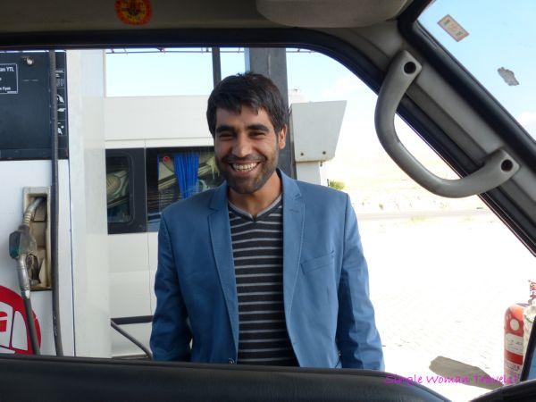 Turkish man at gas station requests his photo to be taken at Lake Van Turkey