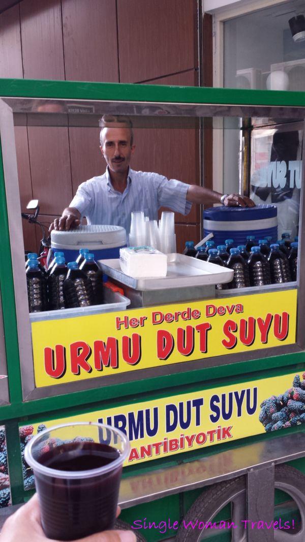 Turkish man selling delicious antibiotic juice in Gaziantep Turkey