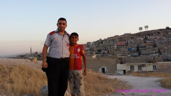 Turkish security guard and his son at Sanliurfa castle Turkey