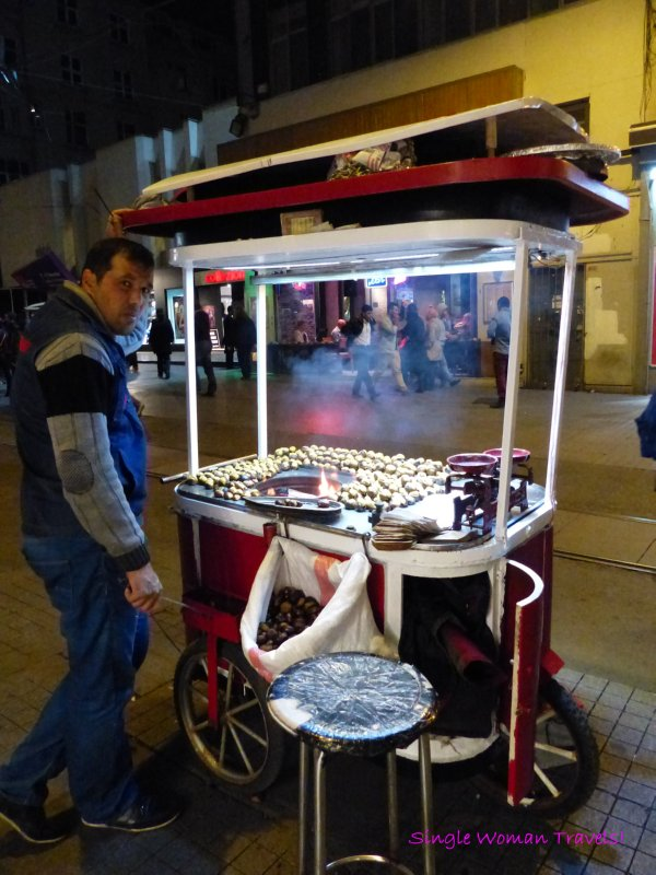 Roasted chestnut vendor on a cold night in Taksim Istanbul Turkey