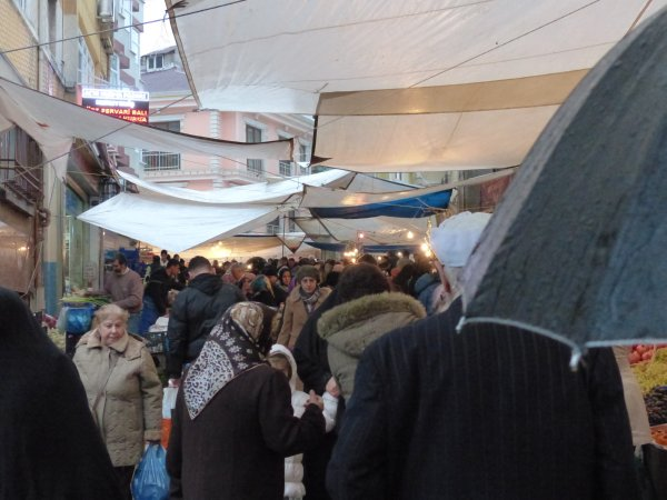 Brace yourself - time to walk shoulder to shoulder in Fatih market Istanbul Turkey