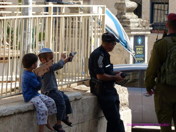 Children of Jewish settlers hanging out with IDF soldiers in Hebron Palestine
