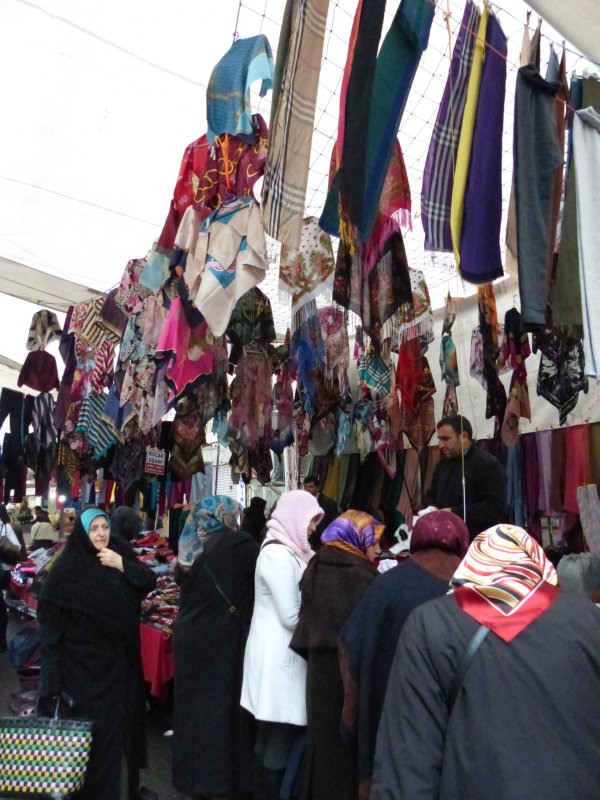 Head scarf vendor busy with customers at Fatih market Istanbul Turkey