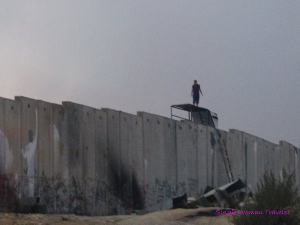 Man on Separation Wall between Israel and Palestine