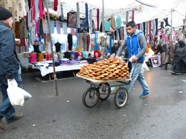Simit vendor seeking cover while the rain starts falling from the sky in Istanbul Turkey