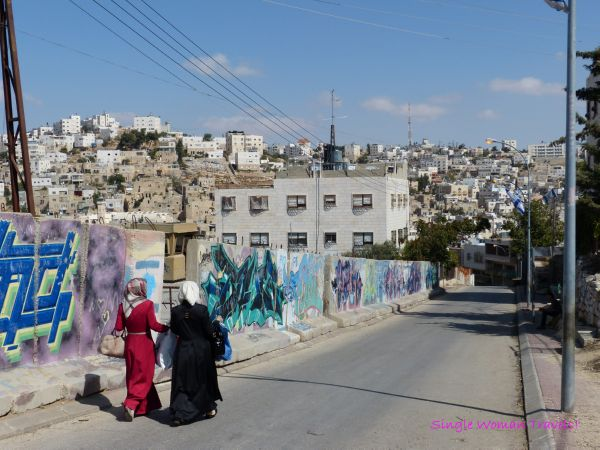 Women walking in ghost town portion of Hebron Palestine